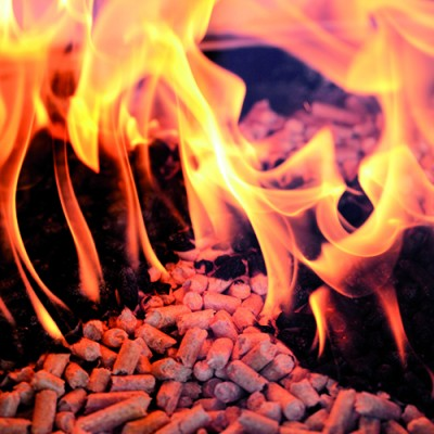 Alternative fuel: Wood pellets burning in a fireplace.